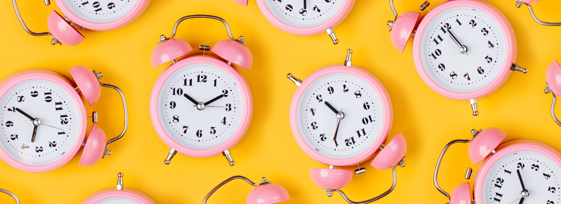 Lots of brightly coloured clocks